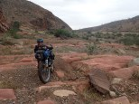 Our road came to a dead end so we pushed the bike across a river and over these sandstone waves.